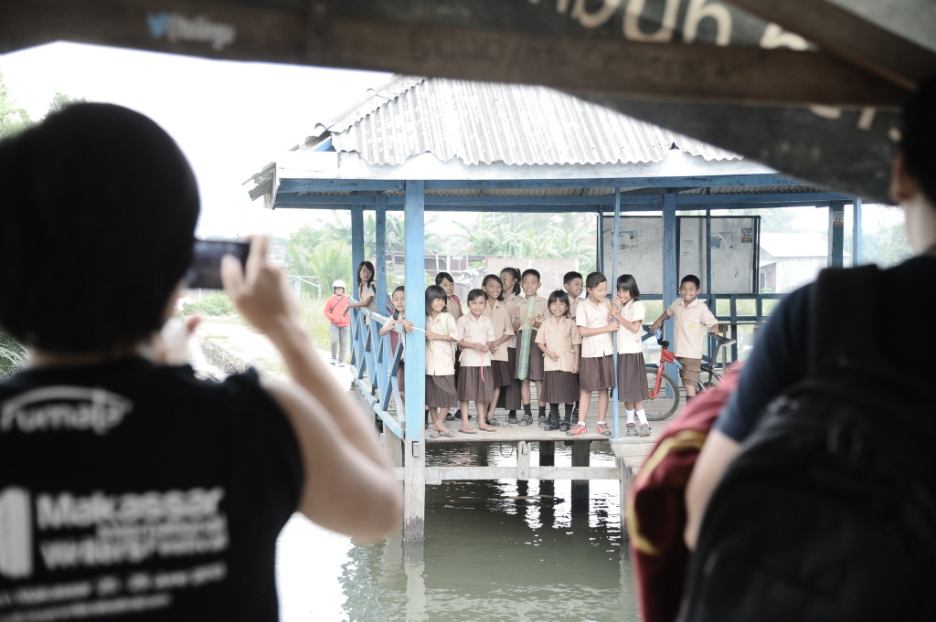 Children waiting for a boat ride to school