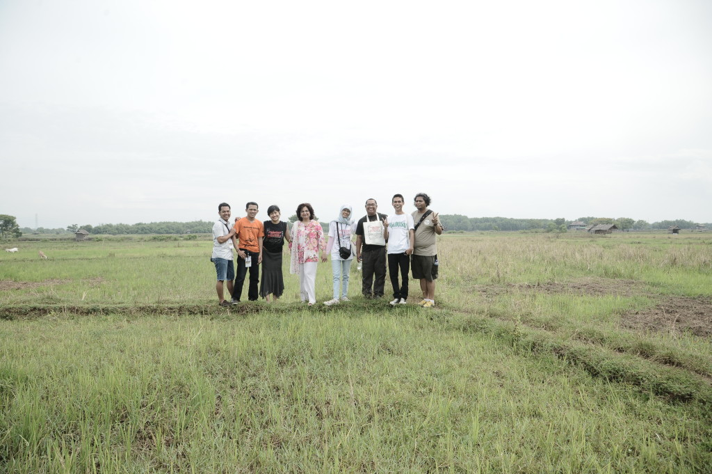 In the paddy fields with our great photographer doing the peace sign